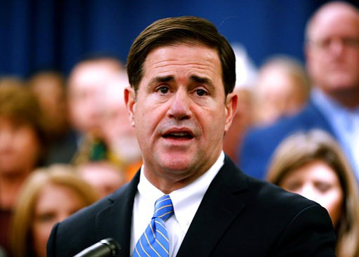 In this Jan. 22, 2018 file photo, Arizona Gov. Doug Ducey speaks prior to signing the order calling the Legislature into a special session at the Capitol in Phoenix. Some top Republicans in the Arizona Legislature want to add armed and specially trained school personnel to Gov. Doug Ducey's proposal to boost school safety. (AP Photo/Matt York, file)