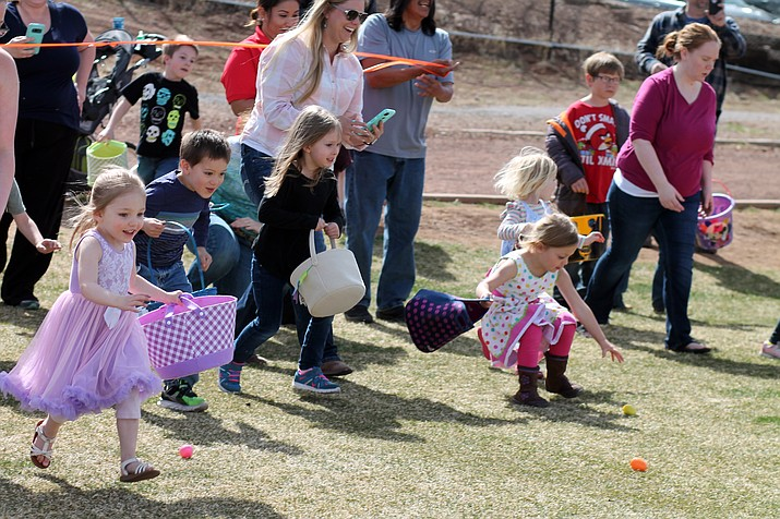 Egg hunters race into the field to collect eggs with candy and special prizes. (Erin Ford/WGCN)