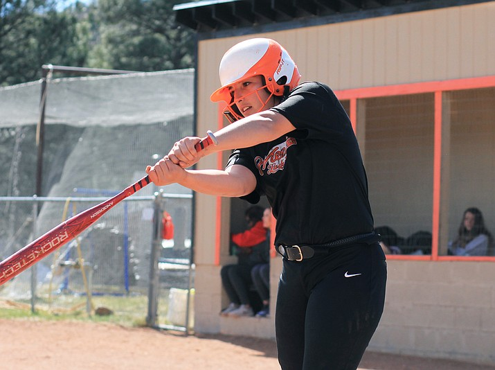 Jazlyn Romero takes a practice swing March 27 during a game with Mogollon.
