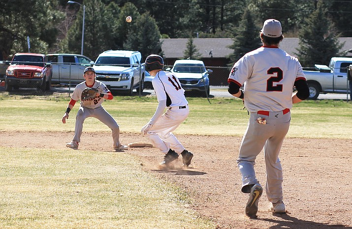 Payce Mortensen gets caught in a rundown during a game with Mogollon March 27. (Wendy Howell/WGCN)