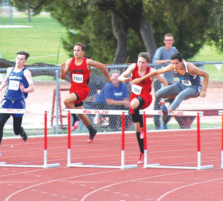 Lee Williams' Enzo Marino, left, and Zack Tempert run the 300 hurdles last season.
