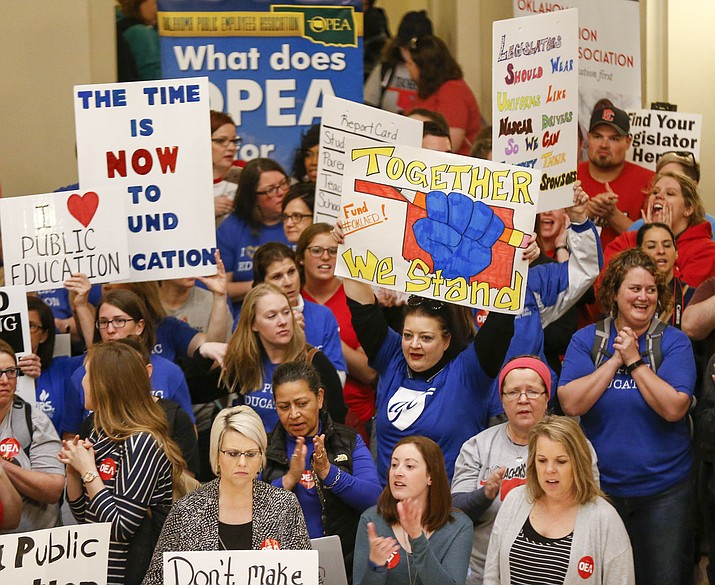 Teachers and supporters of increased education funding rally on second floor rotunda of the state Capitol during the second day of a walkout by Oklahoma teachers, Tuesday, April 3, 2018, in Oklahoma City. (Nate Billings/The Oklahoman via AP)