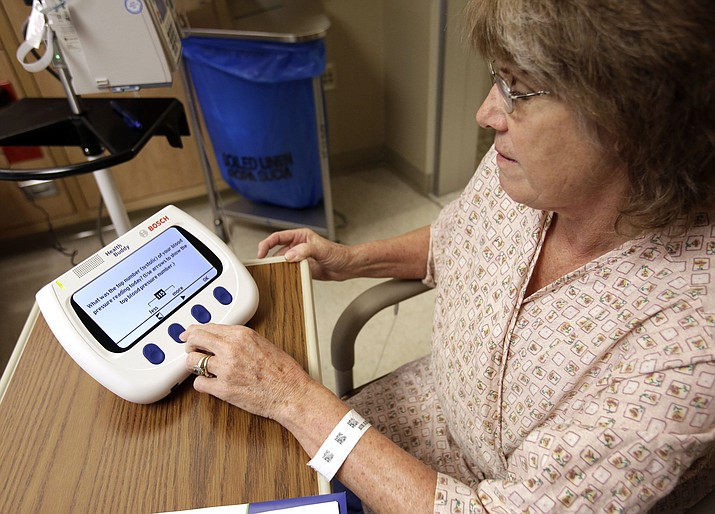 This photo — taken Jan. 30, 2013 — shows Marlena Bechtel-Rysdam, a patient, practicing using a Health Buddy at Oregon Health Sciences University in Portland. (Don Ryan/AP)