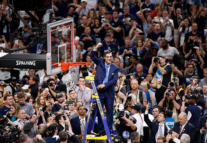 Villanova head coach Jay Wright reacts after cutting down the net after beating Michigan 79-62 in the championship game of the Final Four NCAA college basketball tournament, Monday, April 2, 2018, in San Antonio. (Brynn Anderson/AP)