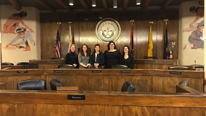 Alternative Spring Break participants from American University Washington College of Law pause for a picture inside the Navajo Nation Council Chambers during their week long internship in Window Rock. (American Univesity Washington College of Law)