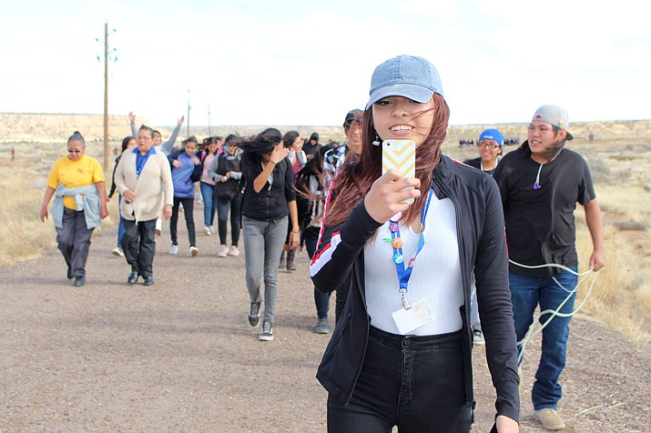 Hopi High media student Serena Leslie takes a selfie during the RISE march at Hopi Jr/Sr High. (Stan Bindell/NHO)