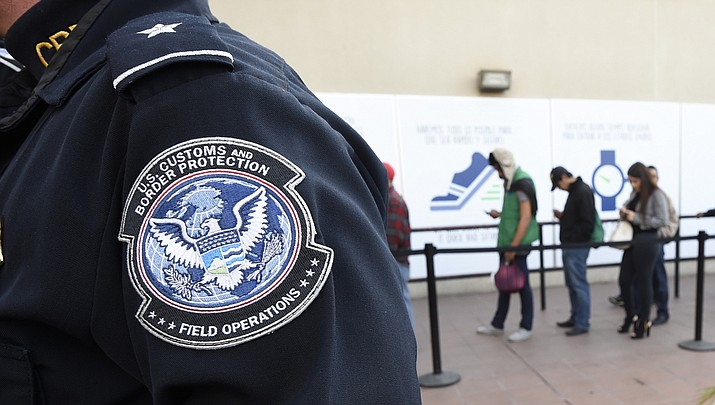 File photo showing a U.S. Customs and Border Protection officer. (AP Photo/Denis Poroy, File)