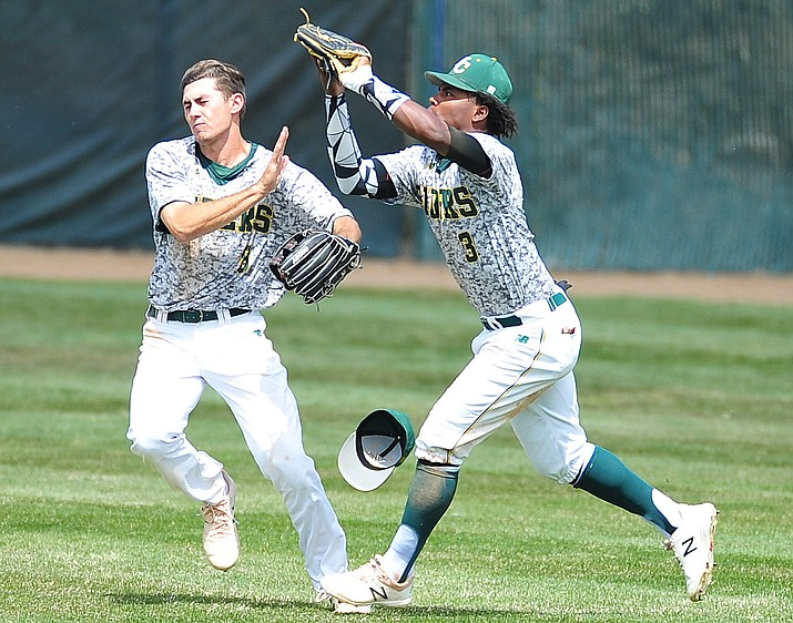 Yavapai's Gianni Tomasi (8) and Over Torres (3) go for a fly ball as the Roughriders host Glendale Community College in the first game of a doubleheader Tuesday, April 3, 2018. Yavapai (21-20, 10-12 ACCAC) split the doubleheader with Glendale, and remain four games back for third place in the ACCAC. (Les Stukenberg/Courier)