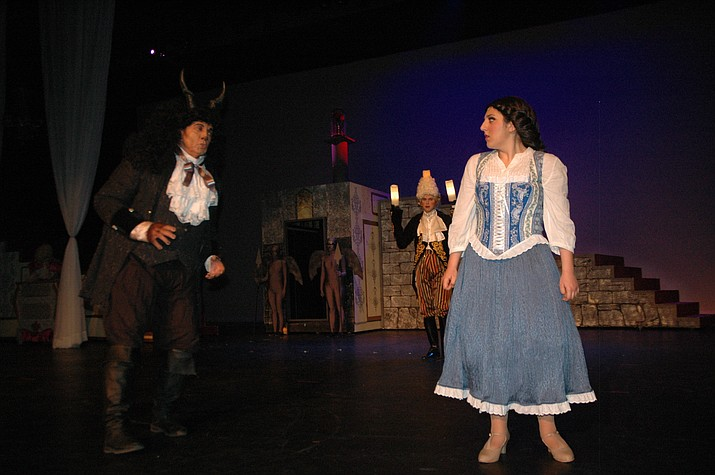 """Mary Rizk as """"Belle"""" gives a disapproving look to Darrel Rowader as """"Beast"""" with Wesley Traver as """"Lumiére"""" in the background. (Jason Wheeler/Kudos)"""