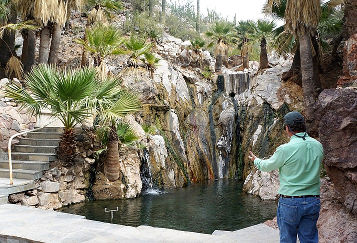 Steve Sampson, director of national sales for the Scottsdale-based Westroc Hospitality firm, shows the upper pool of Castle Hot Springs as it is today. The historic south-Yavapai County resort is being restored, and will be reopened in October 2018. (Cindy Barks/Courier)