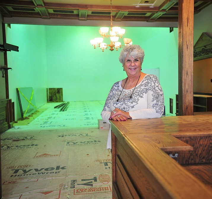 Owner of the former Downtown Prescott Athletic Club Judy Numbers poses inside the downtown building she plans to convert into condominiums Wednesday, April 4, 2018. (Les Stukenberg/Courier)