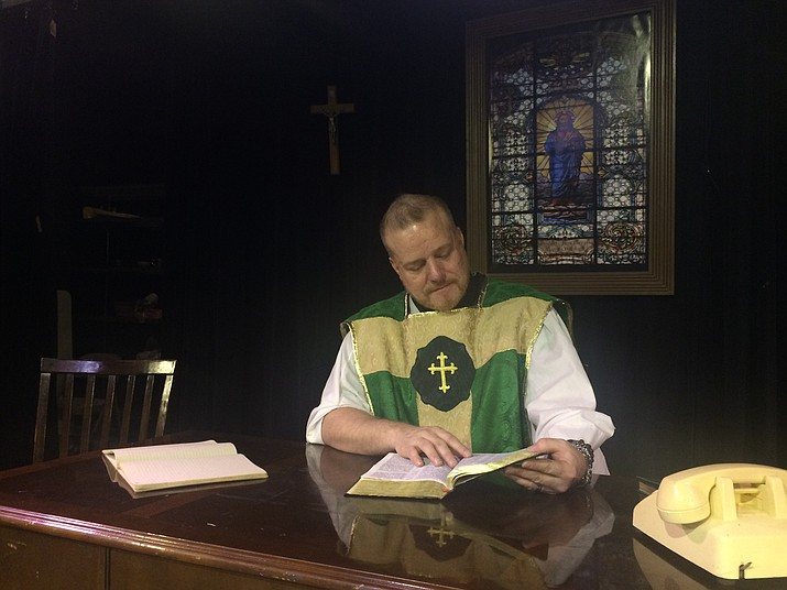 "Michael Dickson, who plays Fr. Flynn in the Prescott Center for the Arts production of ""Doubt: A Parable,"" studies the Bible in character on the set at the theater — 208 N. Marina St., Prescott. The play, winner of the Pulitzer and Tony awards, opens Thursday, April 12. (Jason Wheeler/Kudos)"