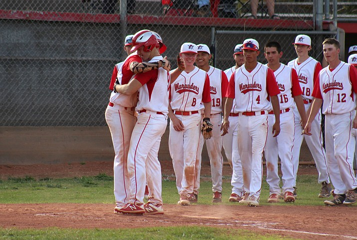 Mingus Union baseball players celebrate senior Justin Link's (9) home run during the Marauders' 7-5 win over Coconino at home on Tuesday afternoon. (VVN/James Kelley)