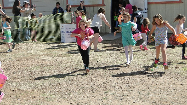 Participants begin their dash to locate Easter eggs. (Courtesy photo)