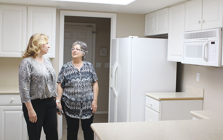 Real estate agent Kathy Ortman, right, of ReMax Prestige Properties, shows a home in Fripps Ranch to prospective buyer Melissa Ellico.