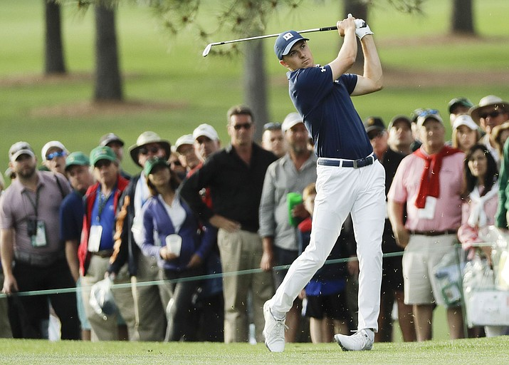 Jordan Spieth hits a shot on the 17th hole during the first round at the Masters golf tournament Thursday, April 5, 2018, in Augusta, Ga. (AP Photo/David J. Phillip)