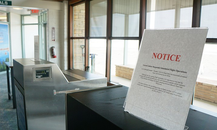 The terminal at the Prescott Airport sits vacant following the suspension of service by Great Lakes Airlines on March 26. Its notice sits on the ticket desk. (Cindy Barks/Courier)