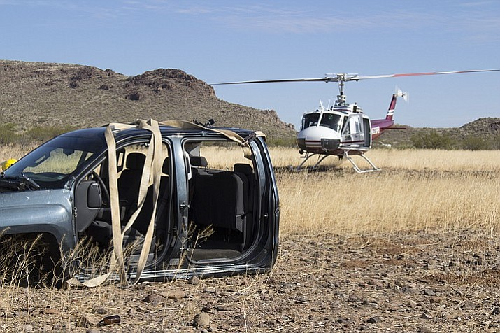A Chevrolet Silverado was removed off a mountain by a helicopter Thursday morning near Kingman. The abandoned truck was fully intact and had to be cut up into pieces by the jaws of life. (Vanessa Espinoza/Daily Miner)