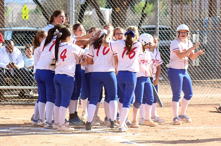 Camp Verde softball celebrates sophomore Bennett Holm's (10) home run on Friday during the Cowboys' 6-5 win over Northland Prep on Friday. It was her first high school home run and first homer that went over the outfield fence. (VVN/James Kelley)