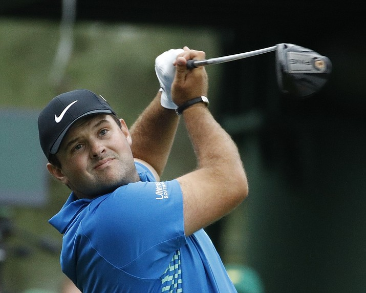 Patrick Reed hits a drive on the 18th hole during the third round at the Masters golf tournament Saturday, April 7, 2018, in Augusta, Ga. (Charlie Riedel/AP)