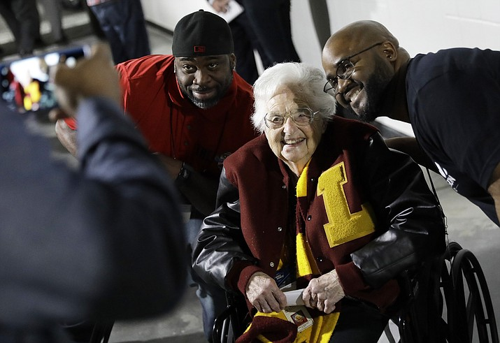 Loyola-Chicago basketball chaplain Sister Jean Dolores Schmidt poses with fans for a photo before the first half of a regional final NCAA college basketball tournament game, Saturday, March 24, 2018, in Atlanta. (David Goldman/AP Photo)