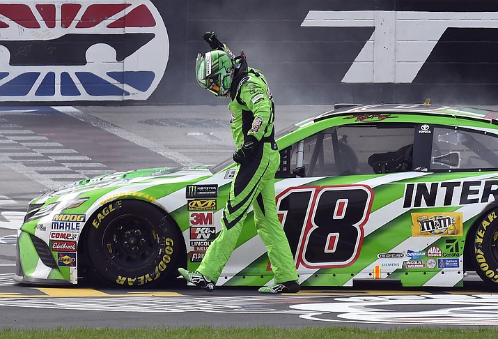 Kyle Busch (18) celebrates after winning a NASCAR Cup Series auto race in Fort Worth, Texas, Sunday, April 8, 2018. (Larry Papke/AP)