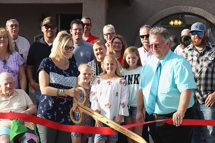 Crystal Finch Brown and Michael Hindenach, president and CEO of the Kingman Area Chamber of Commerce, cut the ribbon at Hope Haven, 2615 Chambers Ave.
