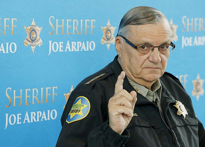 In this Dec. 18, 2013, file photo, Maricopa County Sheriff Joe Arpaio speaks at a news conference in Phoenix. Sen. Jeff Flake's son will seek a new civil trial against Arpaio for bringing a now-dismissed criminal case against him in the heat-exhaustion deaths of 21 dogs. Austin Flake lost a lawsuit against Arpaio at a trial in December, but his attorney says he'll seek another trial because authorities didn't turn over evidence before trial that would have swayed jurors in his client's favor. (AP Photo/Ross D. Franklin, File)
