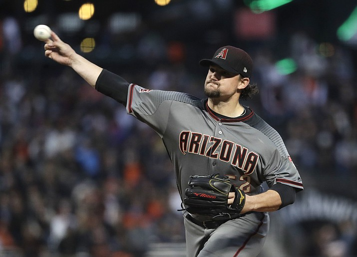 Arizona Diamondbacks starting pitcher Zack Godley throws to the San Francisco Giants during the first inning of a baseball game Monday, April 9, 2018, in San Francisco. (Marcio Jose Sanchez/AP)