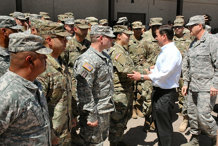 Gov. Doug Ducey greets some of the Arizona National Guard soldiers who are going to be sent to the border to assist Customs and Border Patrol. The governor said the troop deployment is justified by a sharp increase in apprehension of illegal entrants in March versus a year ago and denied that the move, financed by the federal government, is political.
