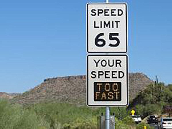 """This photo, from November 2017, pictures one of several safety-message signs that the Arizona Department of Transportation installed at that time to alert drivers to dangerous speeding on the steep, winding stretch of Interstate 17 north of Phoenix. These speed-feedback signs display to I-17 drivers the posted speed limit and actual vehicle speeds. The signs primarily track traffic in the left lane. The southbound I-17 signs are located near Sunset Point Rest Area (milepost 251) and approaching curves on the downhill grade.  The signs are the result of a $1.1 million, I-17 safety project after a study demonstrated that Department of Public Safety troopers had cited """"speed too fast for conditions"""" as the leading driver violation in more than 40 percent of I-17 crashes that occurred in the Black Canyon City area between 2011 and 2015. The speed-feedback signs are a safety tool in an area where crashes and other incidents, including disabled vehicles, can cause closures and lengthy delays along I-17's winding grade. (ADOT/courtesy)"""