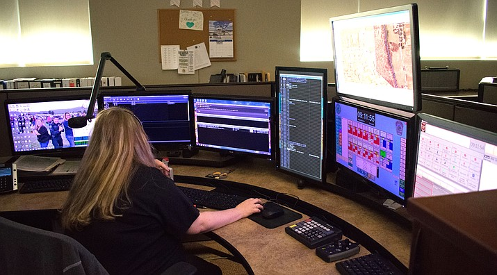 Jennifer Noss, a communications specialistm dispatches emergency services to a call. Noss has worked at the Cottonwood Communications Center for over nine years. VVN/Halie Chavez