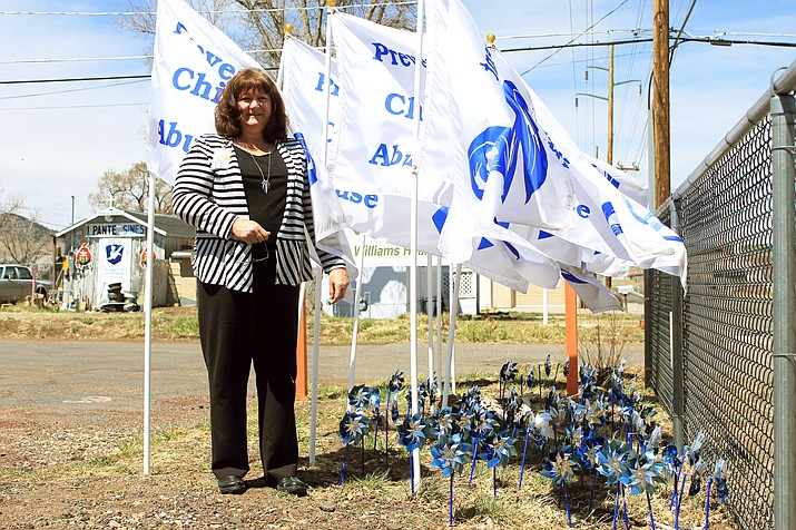 North Country HealthCare Family Health Advocate Linda Taranto planted pinwheels and flags in recognition of Child Abuse Prevention Awareness month. (Wendy Howell/WGCN)