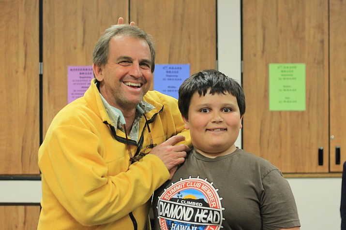 """Big"" Neil Weintraub and ""Little"" R.J. Van Winkle crack jokes during a weekly Big Brothers Big Sister meeting at Williams Elementary-Middle School. (Wendy Howell/WGCN)"