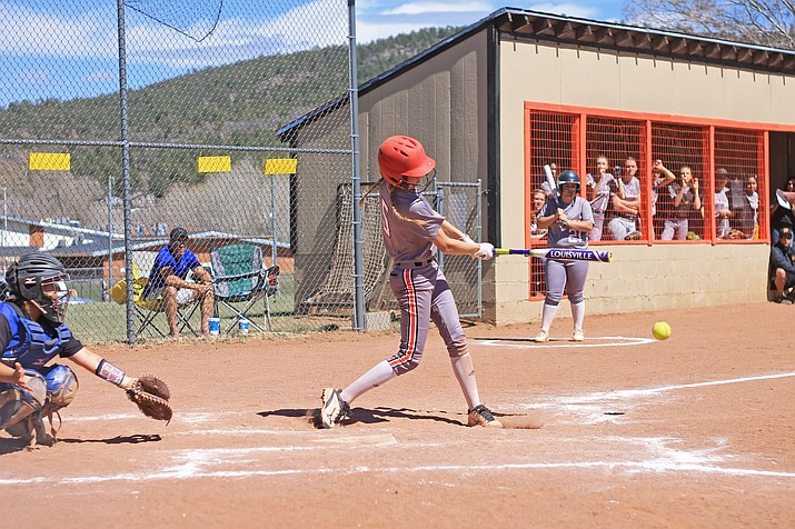 Syndey Mortensen (left) makes a hit at the April 6 game against the Bagdad Sultans in Williams. (Wendy Howell,WGCN)