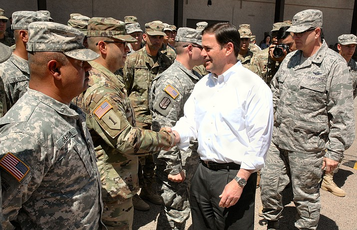 Gov. Doug Ducey greets Arizona National Guard soldiers at the Papago Park Military Reservation in Phoenix Monday, April 9, 2018. The soldiers are to be deployed to assist U.S. Customs and Border Patrol at the U.S.-Mexico border. (Howard Fischer/Capitol Media Services)