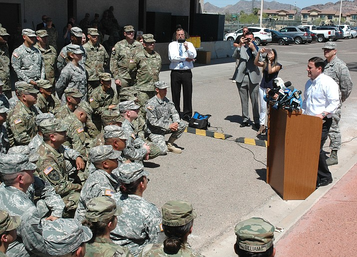 Gov. Doug Ducey greets Arizona National Guard soldiers who are going to be sent to the border to assist Customs and Border Patrol. The governor said the troop deployment is justified by a sharp increase in apprehension of illegal entrants in March versus a year ago and denied that the move, financed by the federal government, is political. (Capitol Media Services photo by Howard Fischer)