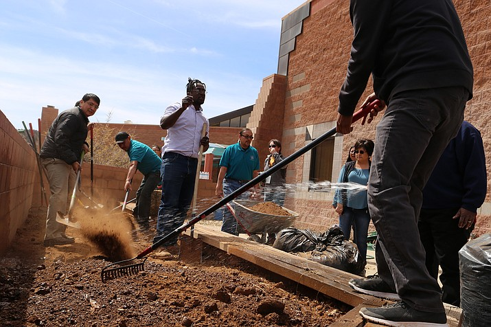 On the third day of the Diné Bich'iiya' Summit held at Diné College participants help build a garden at the Navajo Nation Museum. (Navajo Nation Office of the President)
