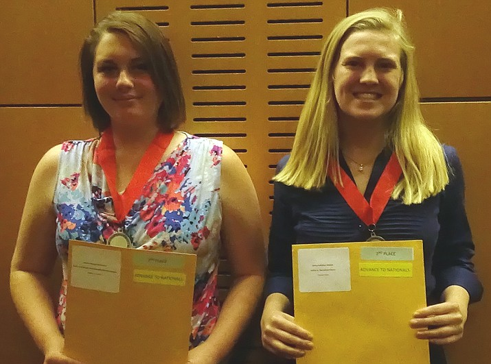 Madisen Cornelius, right, wins 1st place and Phoebe Dunn wins 2nd place at the Arizona state National History Day contest. (Courtesy)