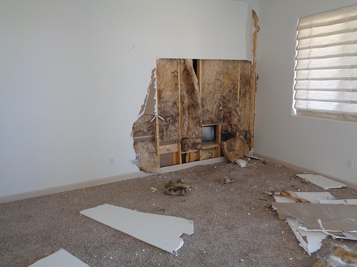 A wall inside a Prescott Valley home was damaged along with a fireplace from a gas leak explosion Monday, April 9. (CAFMA/Courtesy)