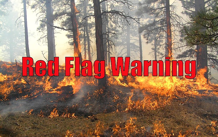The National Weather Service has issued a red flag warning due to critical fire spreading conditions.