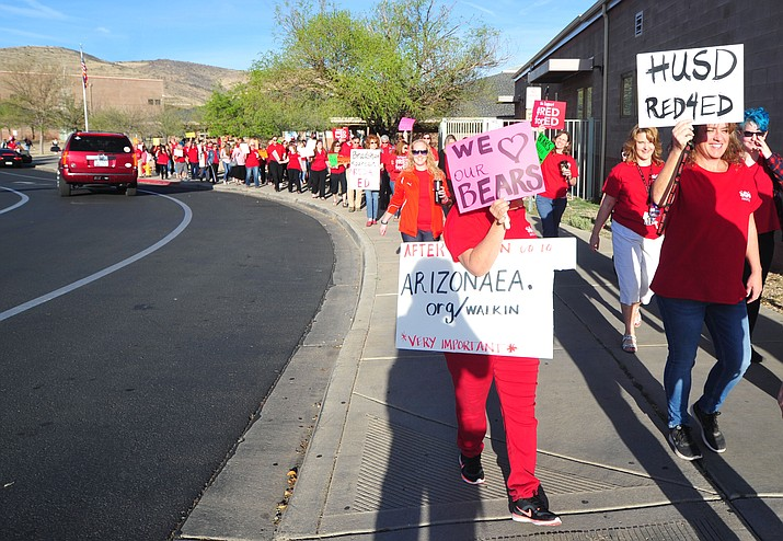 Over 100 teachers, parents, support staff, students and supporters march at Bradshaw Mountain High School to support pay raises for teachers in Arizona on Wednesday, April 11, 2018. (Les Stukenberg/Courier photos)