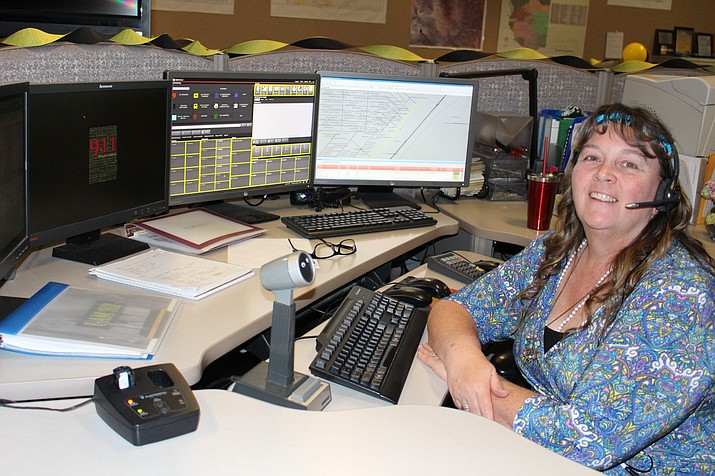 Shelly Morris, dispatcher for Mohave County Sheriff's Office, works the phones Tuesday at MCSO's communications center. She said there are more women than men dispatchers because they're better multitaskers.