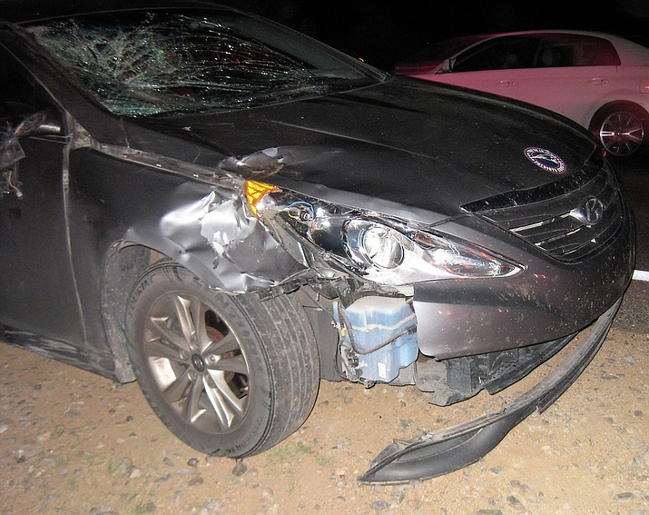 One of the vehicles damaged in a collision with a cow. (Photo courtesy of YCSO)