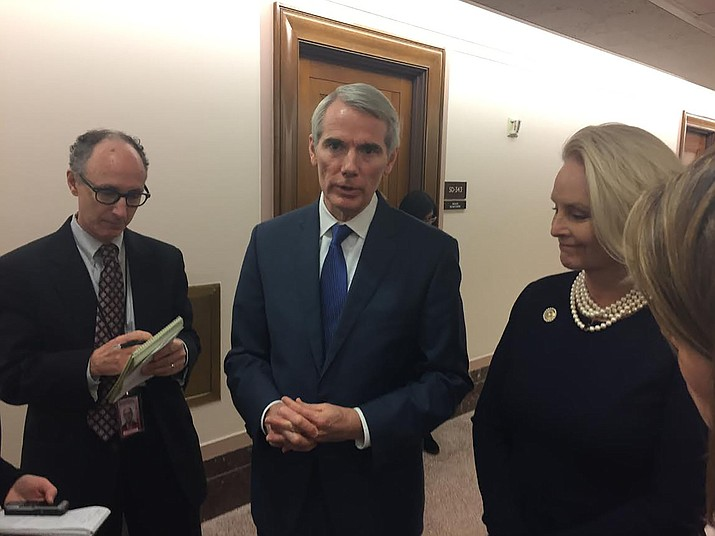 Sen. Rob Portman, R-Ohio, and Cindy McCain after a 2017 Senate hearing on online sex trafficking that targeted Backpage.com. (Photo by Arren Kimbel-Sannit/Cronkite News)