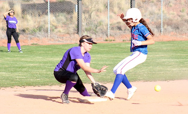 Camp Verde freshman Paige Seneca steals second during the Cowboys' 23-3 win at Sedona Red Rock on Mar. 29. (VVN/James Kelley)