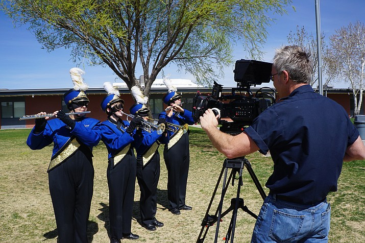 Cable One Producer Ken Anderson, right, films members of the Prescott High School marching band — from left, Mia Davis, Alora Zimmerman, Lila Keane, and Brian Van Vorst — for a public-service commercial on the dangers of distracted driving. The students were blindfolded before trying to march and play their instruments to illustrate the importance of keeping a focused eye on tasks, such as driving. The commercial is the first of several that the Central Yavapai Metropolitan Planning Organization and Cable One are producing in a region-wide campaign against distracted driving. (Cindy Barks/Courier)
