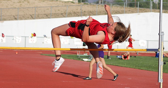 Lee Williams' Trysta Rucker, who later set a new personal best at 4-10, clears the bar in the early rounds of the high jump Wednesday at LWHS.