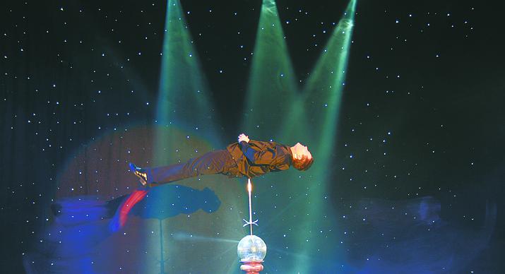 Illusionist Jay Owenhouse balances himself on a pole. (Courtesy)