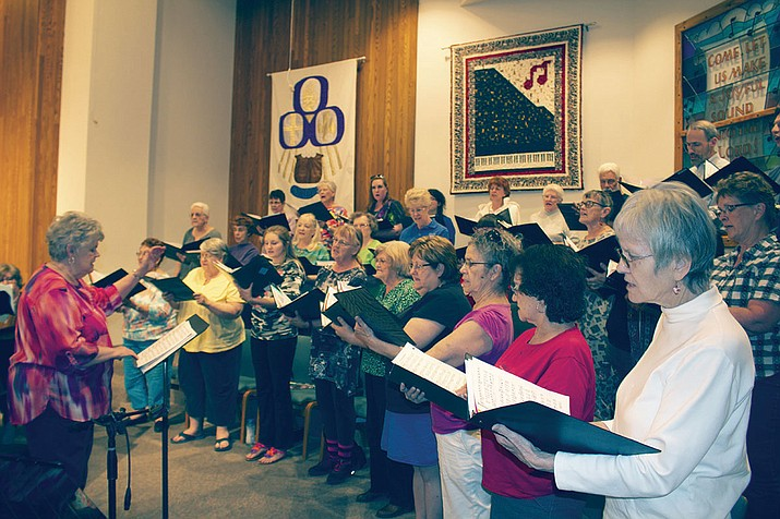 "Melissa Brown leads the Mohave Community Choir during rehearsal for Saturday's ""Celebrate America"" concert at Grace Lutheran Church."
